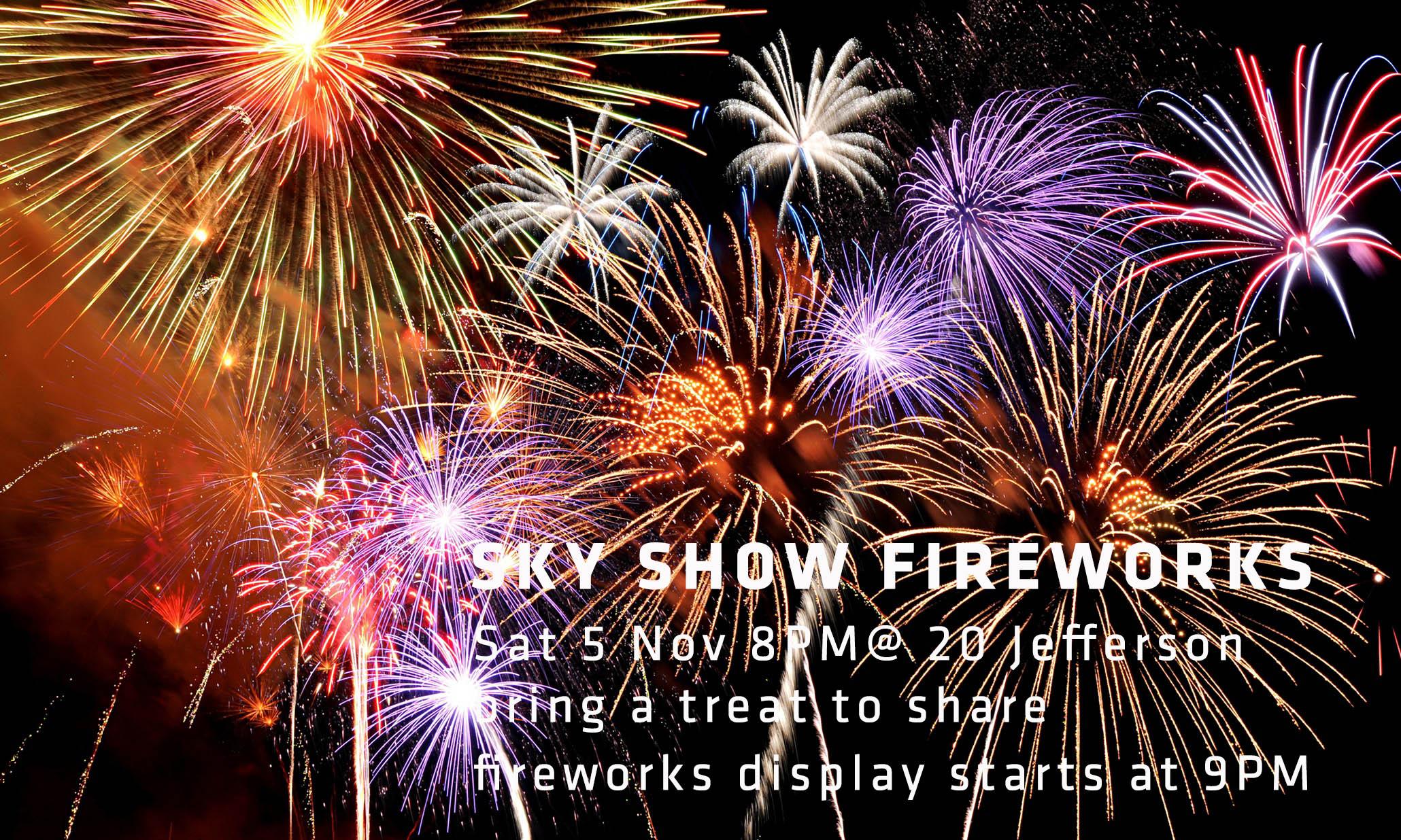 Fireworks of various colors bursting against a black background